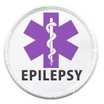badge showing medical staff and word epilepsy over purple medical cross